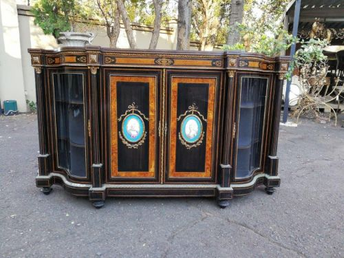 A very large Victorian ebonised amboyna burl wood with gilt-metal mounts credenza/sideboard/display/storage cabinet with shaped glazed doors