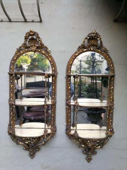 A pair of 19th Century wooden carved and mercury gilded (a far superior and expensive form of gilding) mirrors with shelves ND