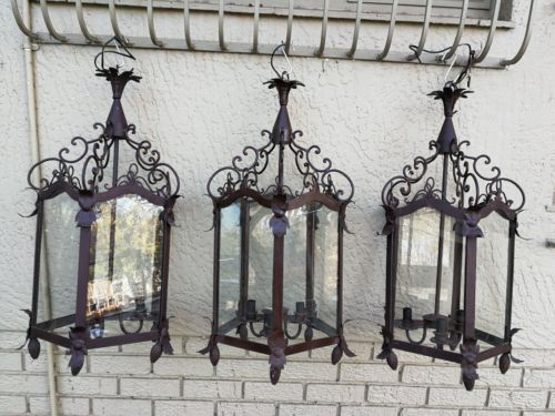 A Set Of Three Large Size Vintage Wrought-Iron Hanging Lanterns For Candles With Drip Trays ND