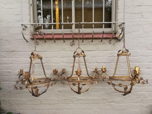 Set of three hanging gilt-metal chandeliers for candles ND