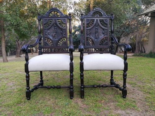 A Wooden And Heavily Carved Pair Or Statement Armchairs