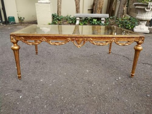 An Early 20th Century French Gilt Wood And Glass Coffee Table