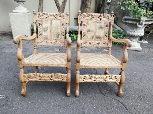 A Pair Or Ornately Carved And Bleached With New Rattan Arm Chairs