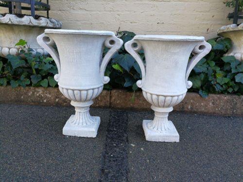 A Pair Of Decorative Concrete Urns