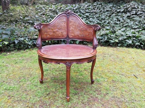 A French Walnut Carved And Rattan Chair
