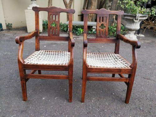 A Pair Of Transvaal Teakwood Armchairs With Typical Herbert Baker Influence And Made By The Renowned Furniture Maker James Smith