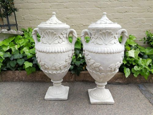 A Pair Of Concrete Urns With Handles And Lids