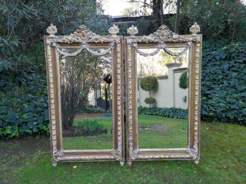 A Pair Of 20th Century Ornate Carved And Gilded Mirrors