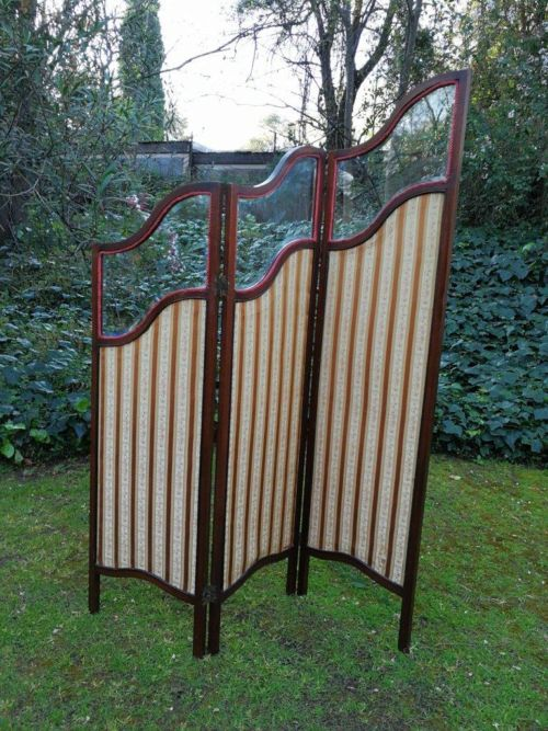 An Edwardian Mahogany Screen With Bevelled Glass