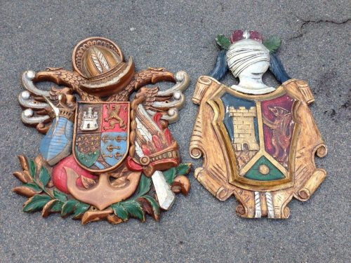 Pair of large carved and painted wooden Coat of Arms