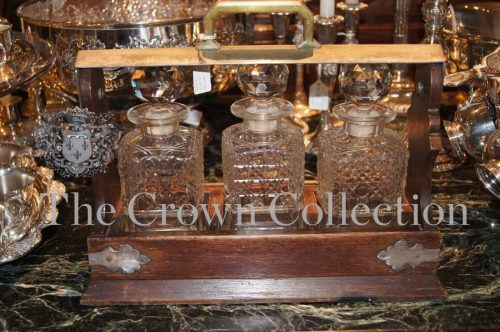 Oak Framed Tantalus with 3 Decanters