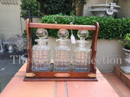 Edwardian Oak Tantalus with 3 Matching Crystal Decanters