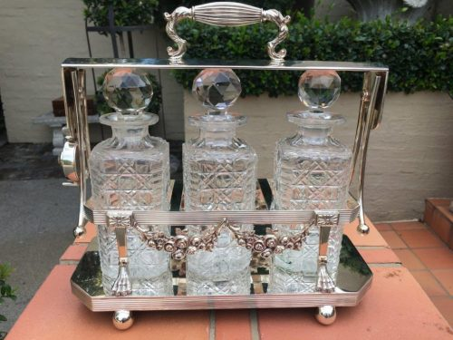 Edwardian Silver Plated Three Bottle Tantalus (Not the original bottles)