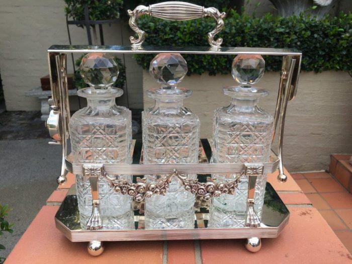 Edwardian Silver Plated Three Bottle Tantalus (Not the original bottles)