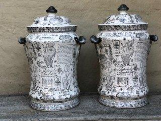 Pair of Vintage Urns with Lids with Script and Mixed Design