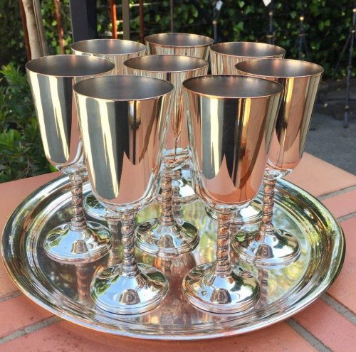 A set of 8 x Mappin & Webb silver plate wine glasses and circular tray