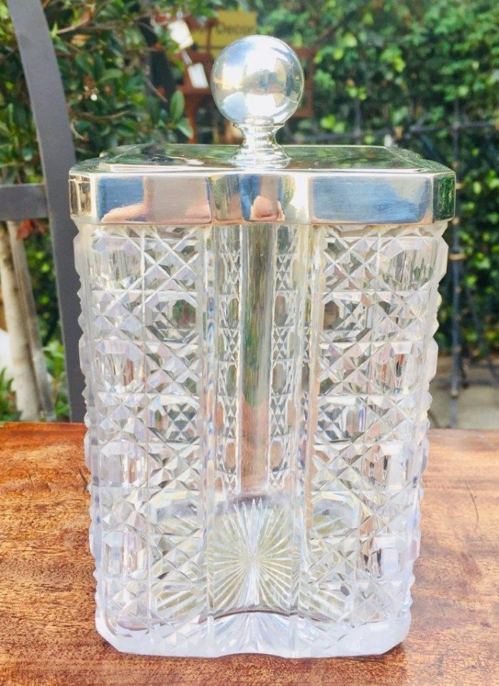 A late 19th Century Silver and Clear glass biscuit barrel