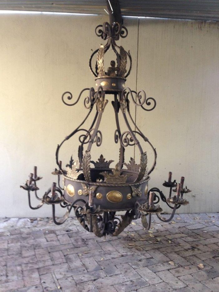 A Large round base Wrought Iron Hand painted Chandelier with crown detail