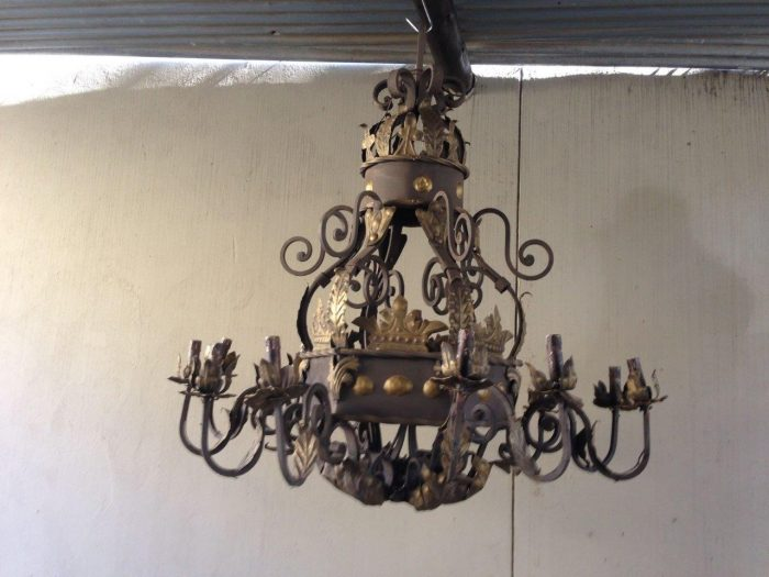 A Hexagonal base Wrought Iron Hand Painted Chandelier with crown detail