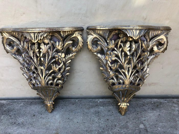 Pair of ornately carved and gilded wall sconces