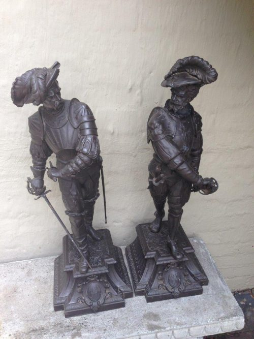 "A pair of late 19thC/early 20thC spelter ""Cavalier"" Figures"