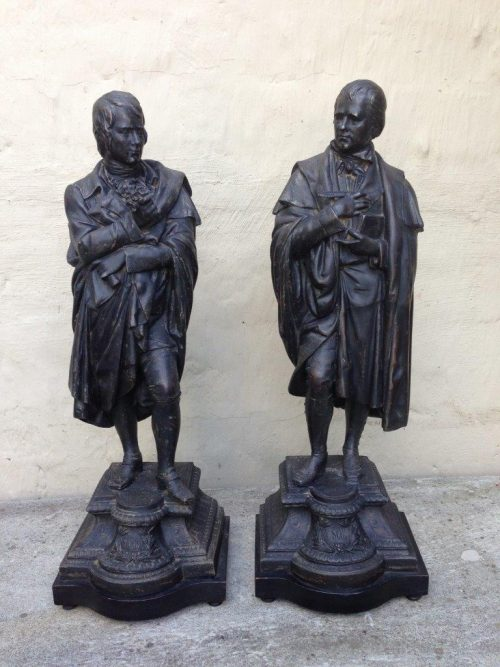 A pair of spelter figurines of  Robert Burns and W Scott. Both signed by the artist.