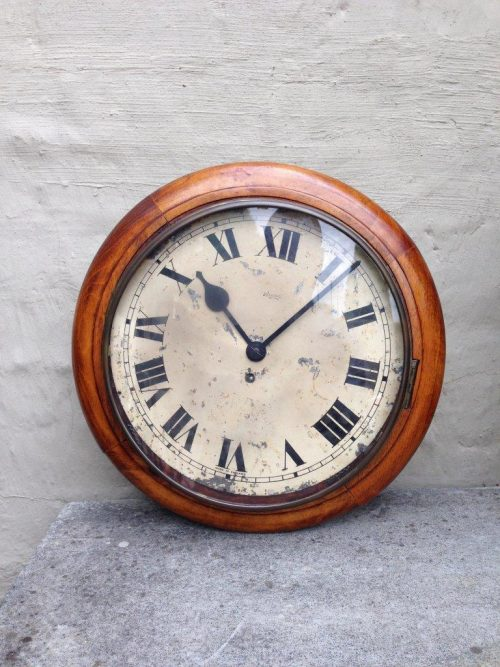 A late Victorian Walnut wall clock with pendulum and winder