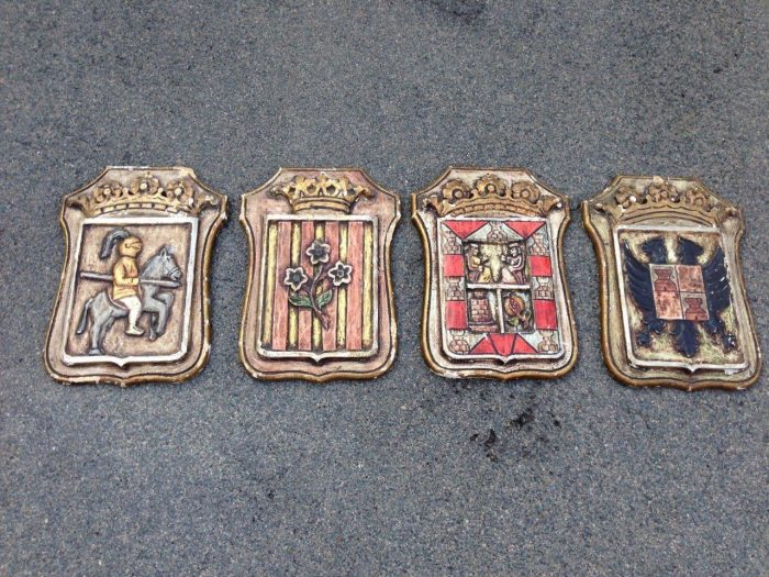 Set of 4 (four ) carved and painted shield wall plaques