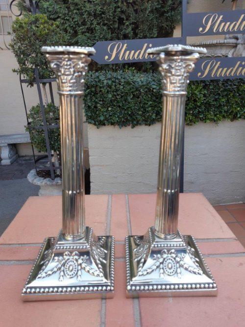 Pair Of Silverplate Corinthian Column Candlesticks