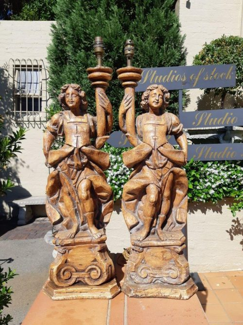 Pair of Continental carved wooden figural lamps