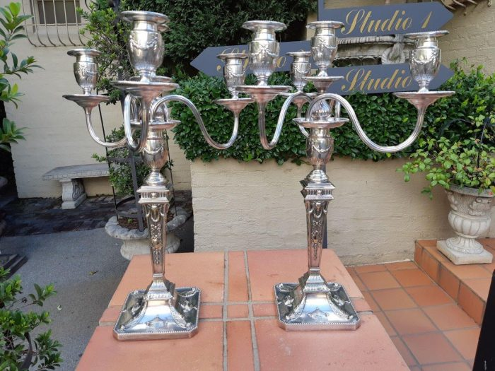 A pair of silver-plated four-light candelabra