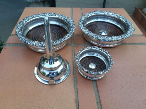 A set of silver plate comprising a pair of wine coasters