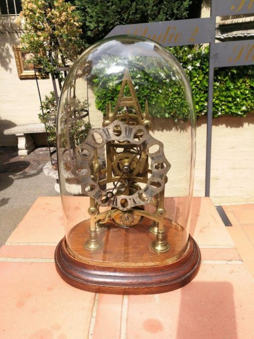 A Brass Skeleton Clock With Glass Dome And Key - ND
