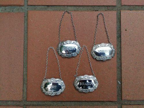 A Set Of Four Elizabeth Ii Silver Decanter Labels