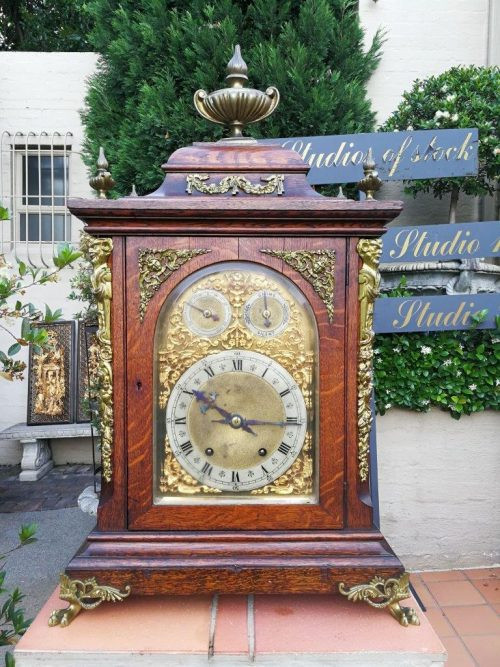 A Oak And Gilt-Metal Table Clock On Lion-Paw Feet