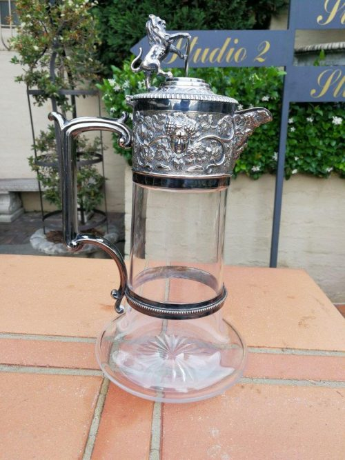 A Glass Claret Jug With Electroplate Mounts