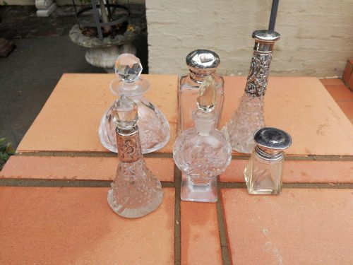 A Collection Of Crystal And Silver Scent/Perfume Bottles