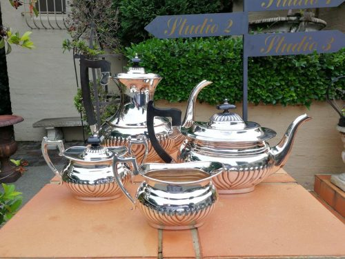 A Mid 20th Century Silverplated Four Piece Tea Service