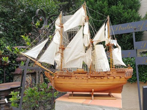 """A model ship of the French """"Saint Geran"""" from the 18th century raised on a wooden stand"""