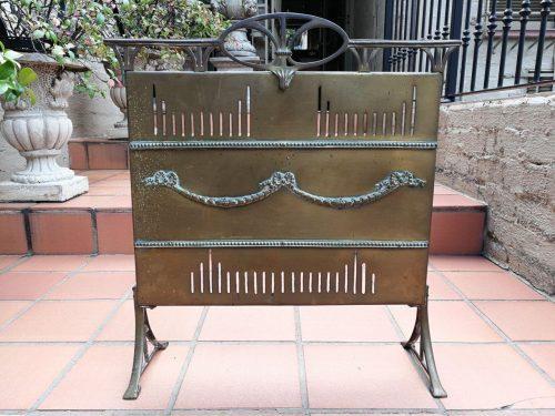 A Victorian brass fire screen