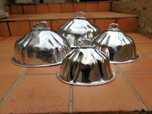 A late 19th century set of four graduated silver-plate food domes ND