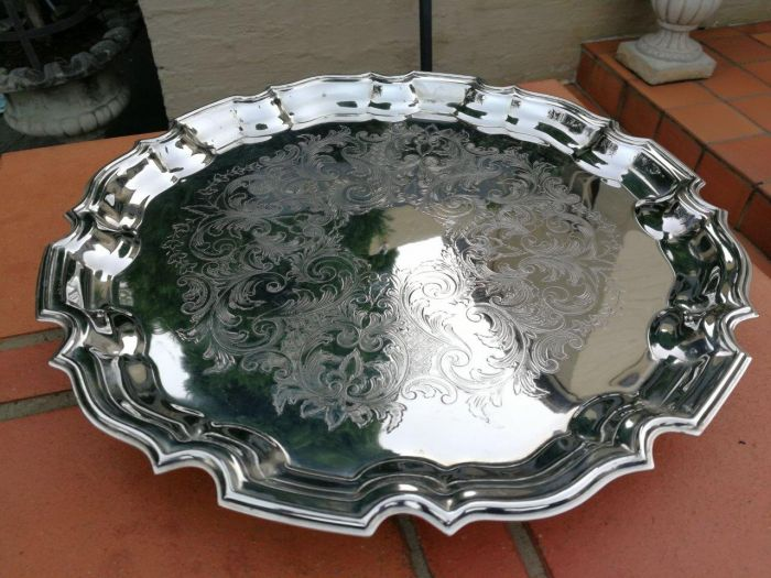 Silver-Plate Circular Tray Standing On Four Paw Feet