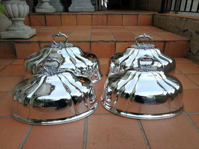 A Set Of Four Silver-Plate Food Domes