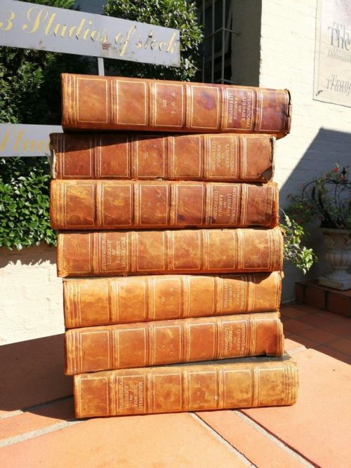 A Set of seven decorative books for bookcases or tables