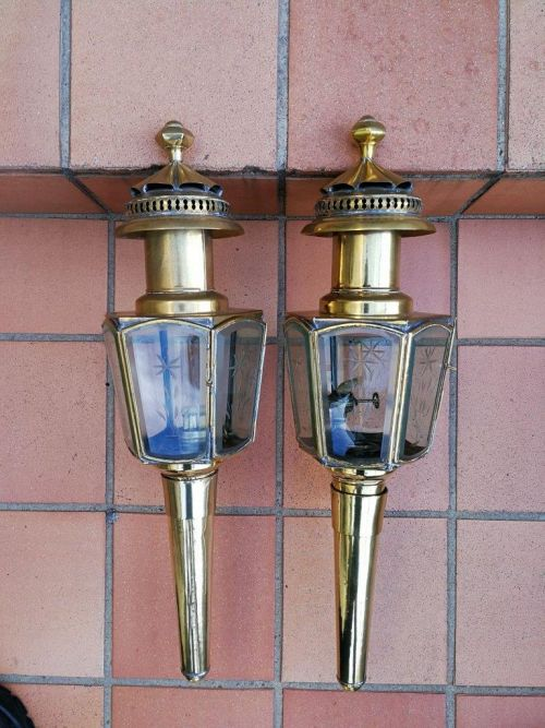 Pair of antique brass carriage lanterns with original crystal cut glass panels and brass brackets for wall mounting