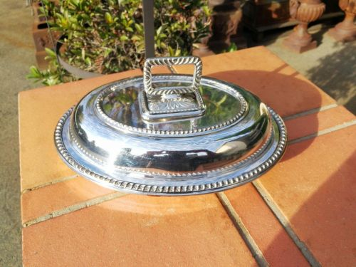 A silver-plate entrée dish and cover