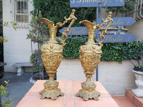 A Pair Of Late 19th Century Gilded Ewers